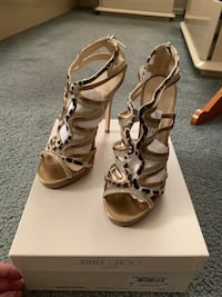 Jimmy Choo 36 1/2 fits a size 7. Wore once