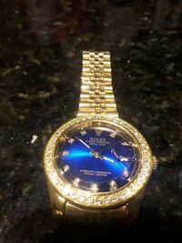 round gold-colored Rolex analog watch with link bracelet Toronto