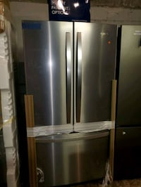 Whirlpool French doors fridge NEW scratch and dent Baltimore, 21223