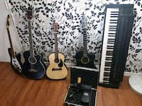 two black and white acoustic guitars Toronto, M6K 2T5