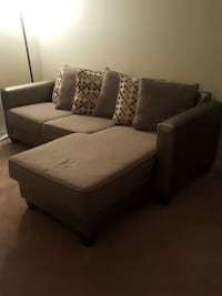 brown fabric sectional sofa with throw pillows