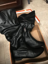 pair of black leather round-toe stockman-heeled knee-high boots Killeen, 76542