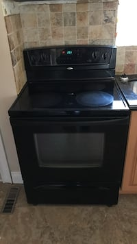 Whirlpool Black induction range oven and microwave oven