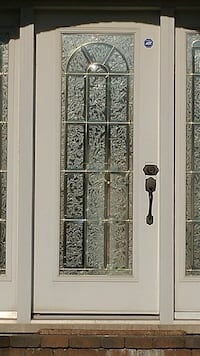 white metal framed frosted glass door