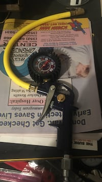 black and yellow tire inflator gauge