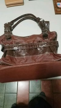 brown and black leather tote bag Laval, H7W 2G8
