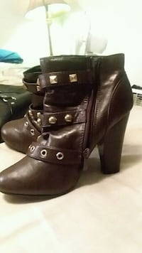 pair of women's studded brown leather almond-toe h