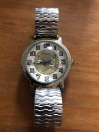round silver Fossil analog watch with silver link bracelet