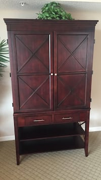 red wooden tv cabinet with 2 drawers