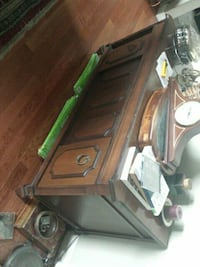 brown wooden framed glass top table North Saanich, V8L 3Z5