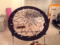 round black and white bungee chair