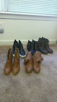 two pairs of brown leather boots