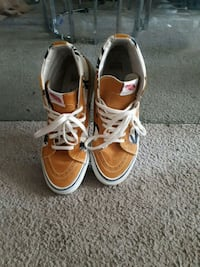 pair of brown-and-white boat shoes Winnipeg, R2H 0X9