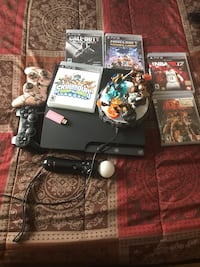 PS3 controllers with games for sale