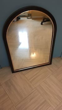 arch mirror with brown wooden frame