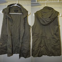 Green vest, never worn, and size medium. I've never worn the vest except tried it on. Fayetteville, 28314