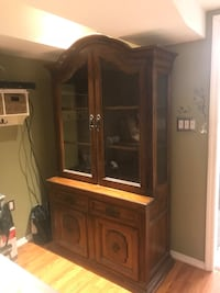 "Solid wood china cabinet with storage. 6'7""x3 1/2x22"" with display light New York, 10306"