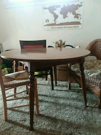round brown wooden table with four chairs dining s Washington, 20016
