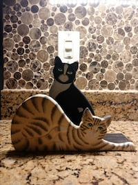 two black and beige cat taxidermy