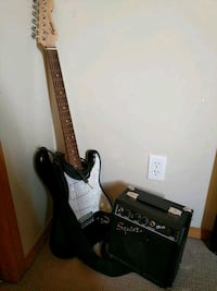 black and brown stratocaster electric guitar and black Squier guitar amplifier Winnipeg, R2P 2Z7