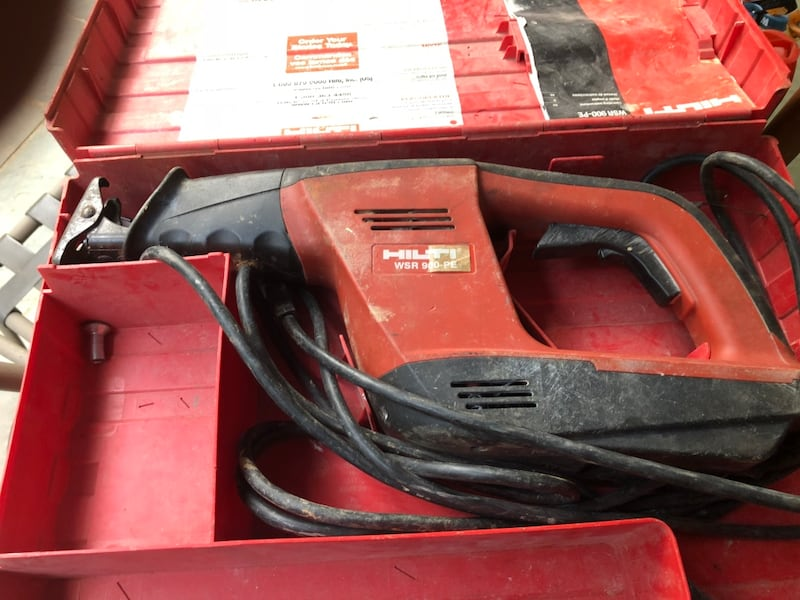 Red and black milwaukee reciprocating saw 9587bdd4-e4bd-446a-b34b-5b9473d872a1