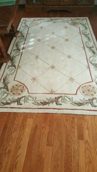brown and white floral textile rugs and runner Waldorf