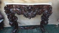 brown wood-framed floral marble top side table