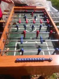 brown and green foosball table null