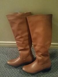 pair of brown leather knee-high boots