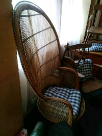 Old wicker chair with cushion  Cambridge, N3H 4A7