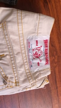 Tan and gold true religion jeans for men. Houston, 77072
