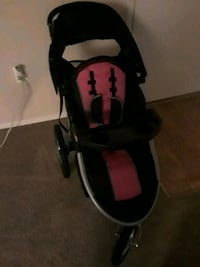 baby's black and pink stroller 52 km