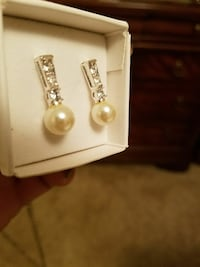 pair of silver-colored-and-pearl earrings