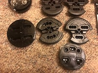 four black barbell plates and two dumbbells Capitol Heights, 20743