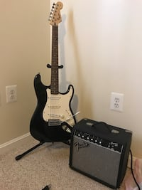 Black and white stratocaster guitar with guitar amplifier Purcellville, 20132