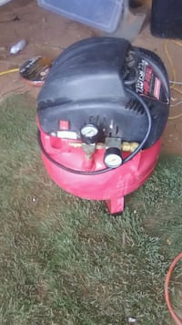 red and black air compressor Midland, 79707