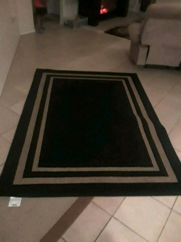 rectangular brown and black area rug