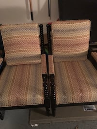 Two brown wooden framed armchairs. From pier 1 imports. Multi colored pattern able to enhance any furniture decor or office. Will take best offer, no delivery. Selling due to relocation. 180 for the pair.  Pasadena, 21122