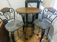 round brown wooden table with two chairs Pub still Cornwall, K6J 2R7