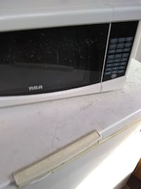 black and gray Emerson microwave oven CALGARY