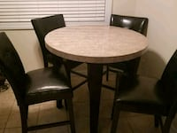 round wooden table with four chairs dining s Patchogue, 11772