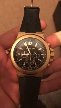 Round gold-colored michael kors chronograph watch with black leather band
