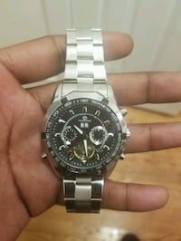 round silver chronograph watch with link bracelet Mount Vernon