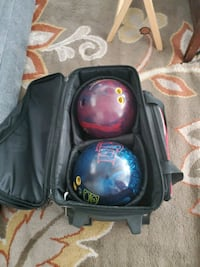 Two pro bowling balls and carrying case with wheels  Las Vegas, 89139