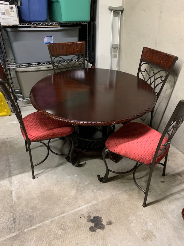 Brown wooden dining/kitchen table with chairs.