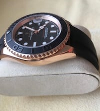 round black analog watch with black leather strap Brossard, J4Z 3C4