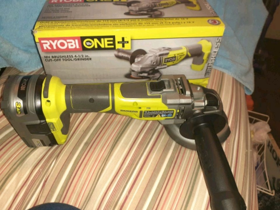 Photo Ryobi cordless angle grinder plus 2 batteries and charger