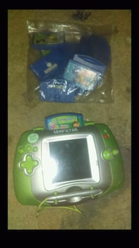 white and green Leap Frog Leap Pad with case 2272 mi