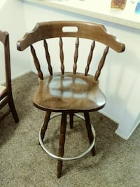 3 brown wooden windsor chairs