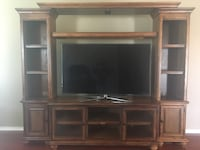 "Wood entertainment center. Fits up to 60"" tv. 7'8"" wide by 6'6"" tall. Tv not included Selma, 78154"